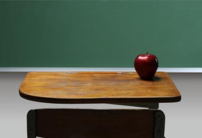 """empty desk, symbolizing an absent student"""
